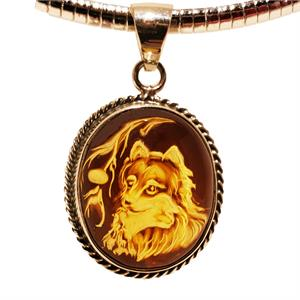 Amber Pendant With Wolf Carving