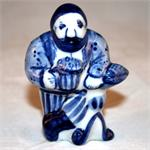 Man with Beer Figurine